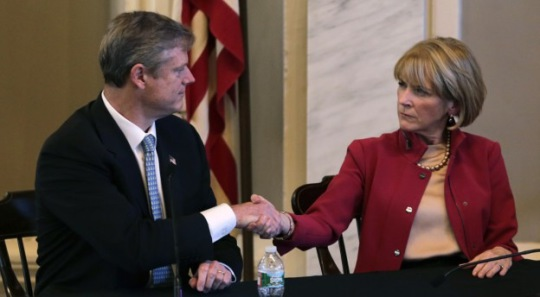 Mass. Republican nominee for governor Charlie Baker, left, shakes hands with Democratic nominee Martha Coakley following a candidates forum (AP Photo/Charles Krupa)