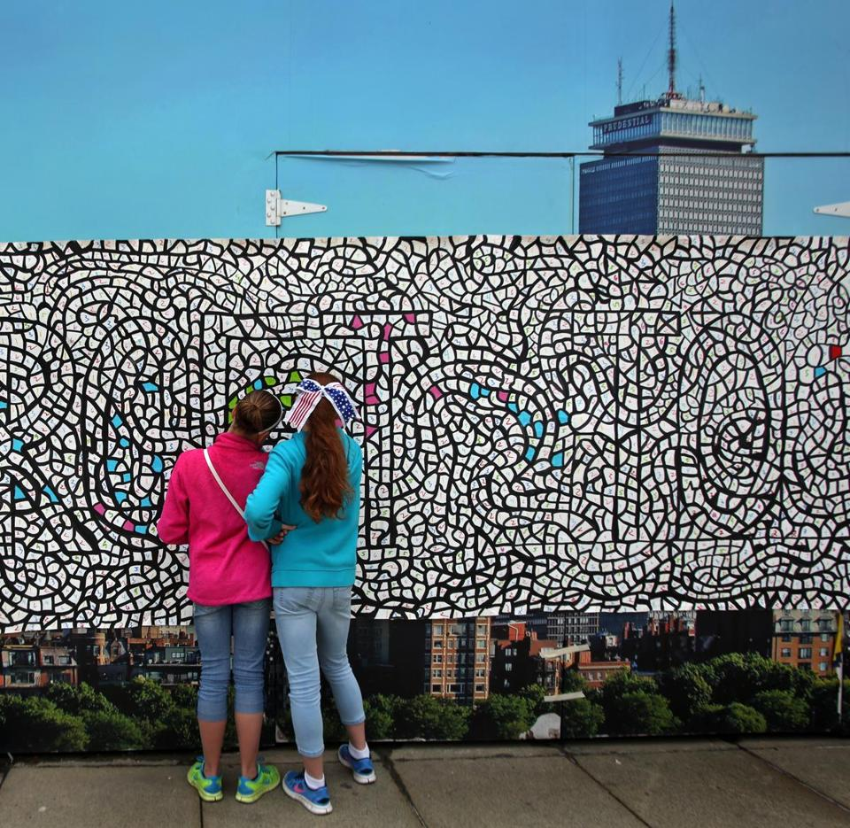 A 60-foot community mural was created outside of the Prudential Center on Memorial Day last year. Photo: Globe file