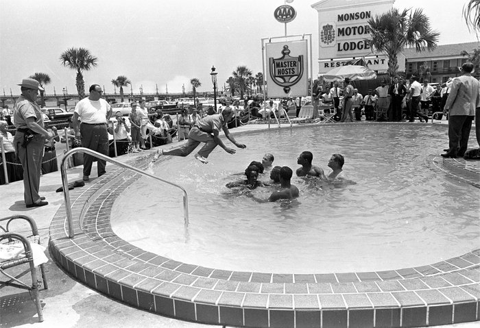 When the group of white and black integrationists refused to leave the motel's pool, this man dived in and cleared them out. All were arrested. Horace Cort/AP