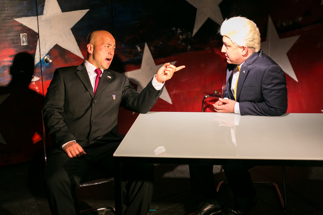 "CHESHIRE ISAACS/IMPACT THEATRE GOP presidential candidate Len (played by Michael Uy Kelly) is interviewed by a cable news personality (Matthew Lai) in ""Mutt,"" a wild satire about race and politics playing at Berkeley's Impact Theatre. ( it )"