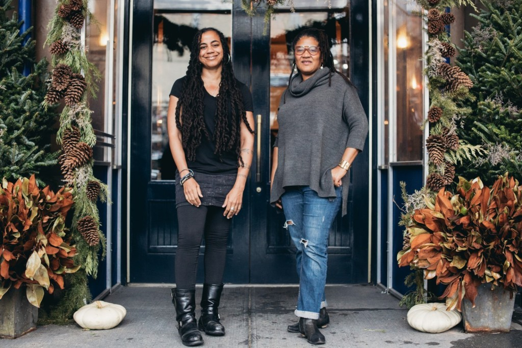 Pulitzer-winning playwrights Suzan-Lori Parks, left, and Lynn Nottage stand outside Lafayette Cafe in New York City. (Bee Walker/for The Washington Post)